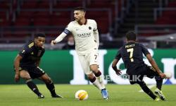 (L-R) - Jurrien Timber of Ajax, Lorenzo Pellegrini of AS Roma and David Neres or Ajax during the UEFA Europa League quarterfinal, 1st leg soccer match between Ajax Amsterdam and AS Roma at the Johan Cruijff Arena in Amsterdam, The Netherlands, 08 April 2021.